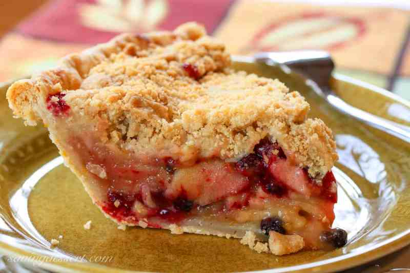 A slice of apple cranberry currant crumb pie