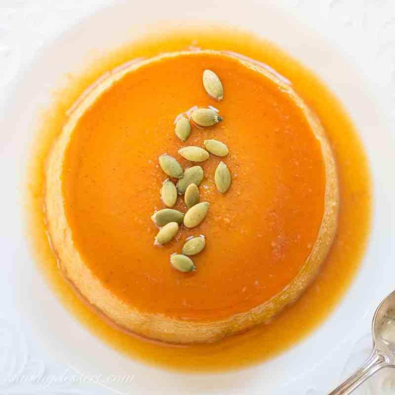 Pumpkin Caramel Flan - a silky smooth, creamy custard that's loaded with pumpkin, and pumpkin pie spice, with a layer of soft caramel on top. www.savingdessert.com