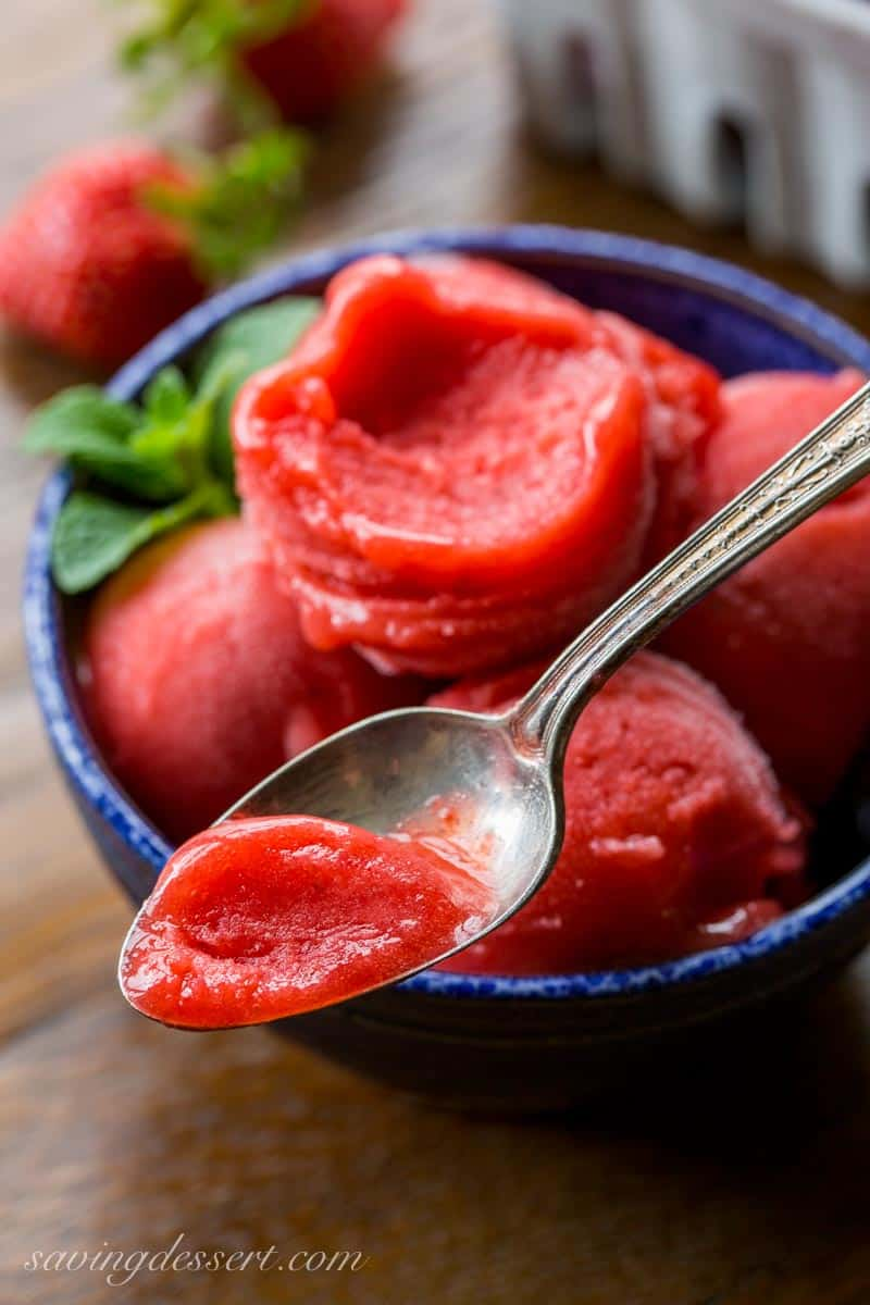 Strawberry Sorbet ~ a simple, easy and delicious sorbet made with only 3 ingredients right in your blender! The intense strawberry flavor is balanced by a few splashes of Grand Marnier which also helps create the incredible texture. www.savingdessert.com