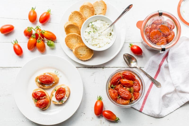 Sweet summer tomatoes are slow cooked in the oven with olive oil, garlic, crushed red pepper and a handful of fresh thyme.  www.savingdessert.com
