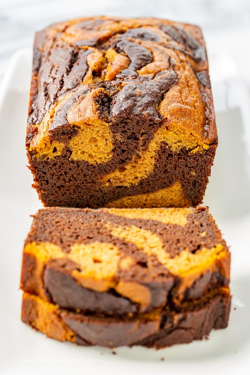 A sliced loaf of chocolate marbled pumpkin bread