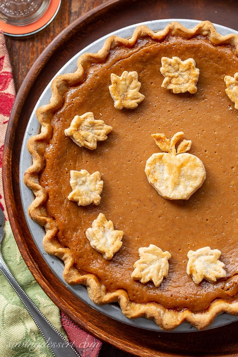 An overhead view of an apple butter pie with crust cookie cutouts on top