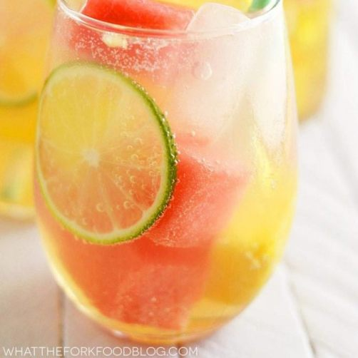 Such a fun twist on summer sangria with watermelon and pineapple