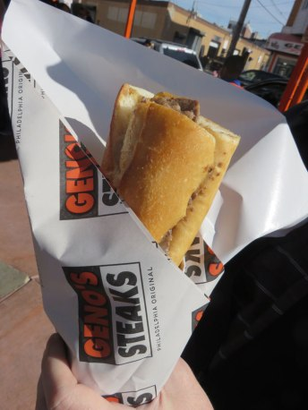 Geno's cheese steak rivals Pat's, with superior cheese to meat ratio,, but less filling and tougher bread.
