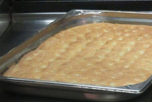 The final product - warm, crispy focaccia bread.
