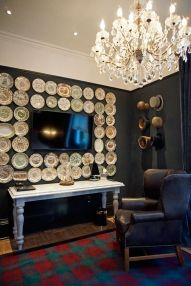 The Mad Hatter room's wall is covered with plates and hats!