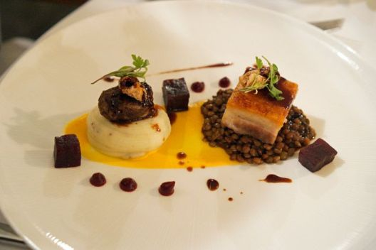 Pork belly and braised pork cheek, with carrot and cardamom puree, spiced lentils and a five-spice jus.