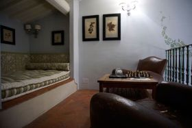 The upstairs reading room in our two-story room at Villa Bordoni