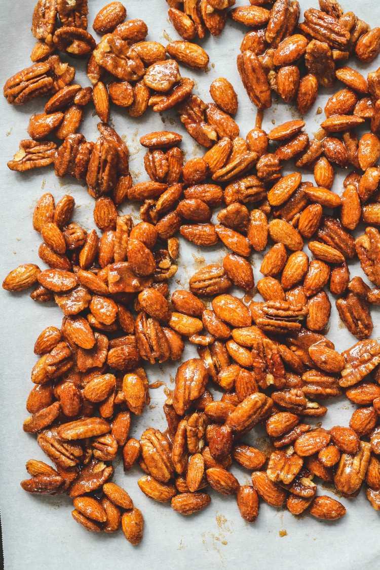 overhead image of nuts on a white background