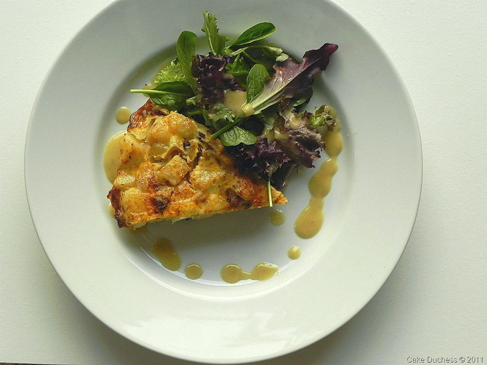 overhead image of eggs and salad on white plate