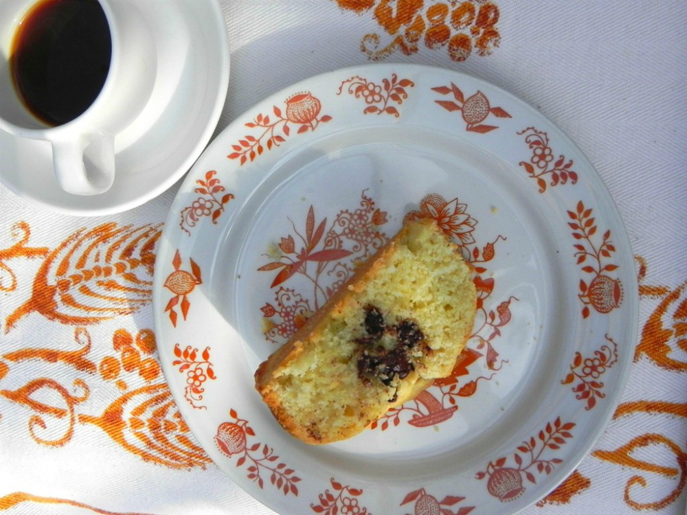 overhead image of cake slice with cup of coffee
