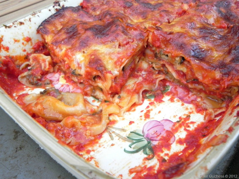 overhead image of layered pasta dish in a casserole
