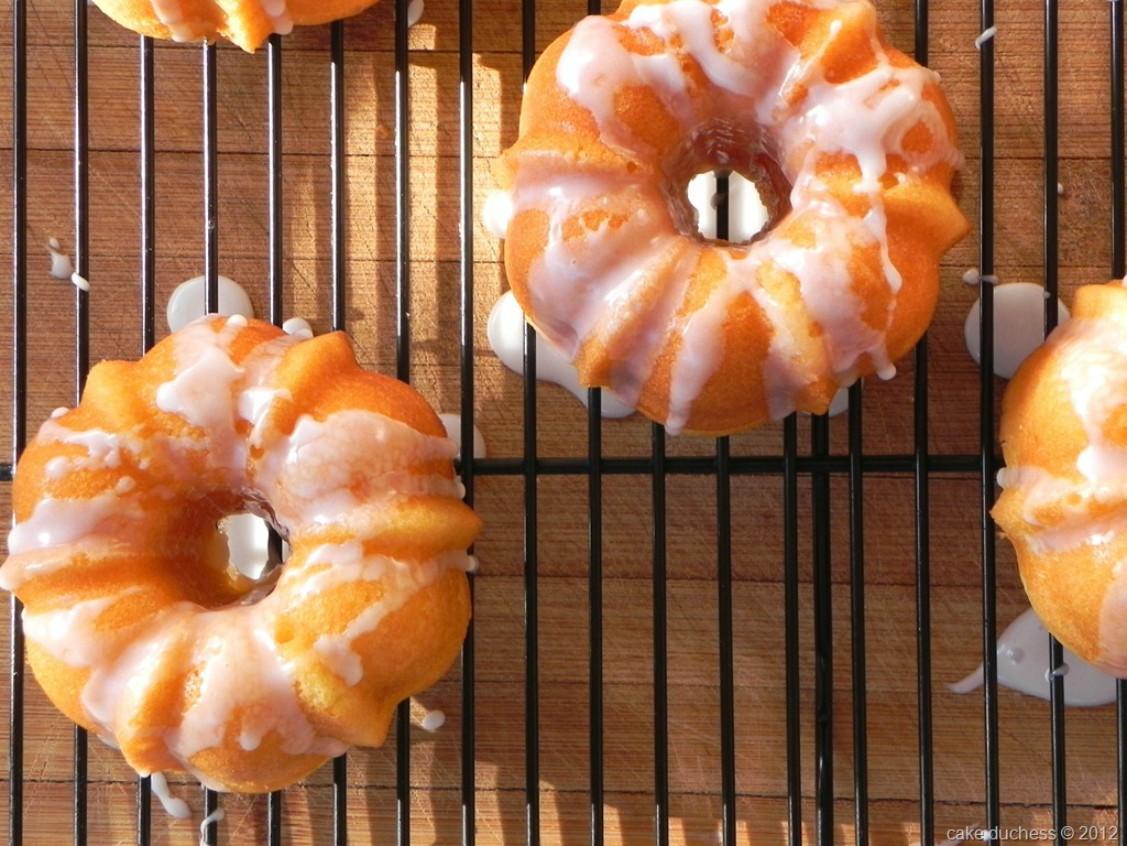 overhead image of orange yogurt mini bundt cakes