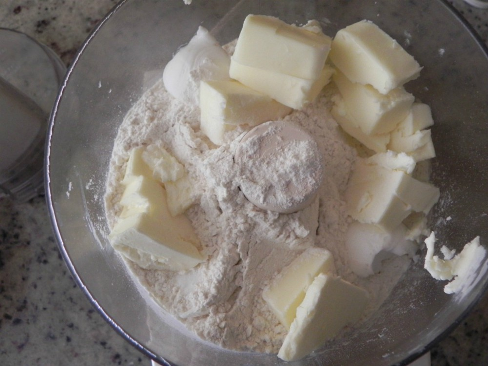 overhead image of making pie crust in food processor