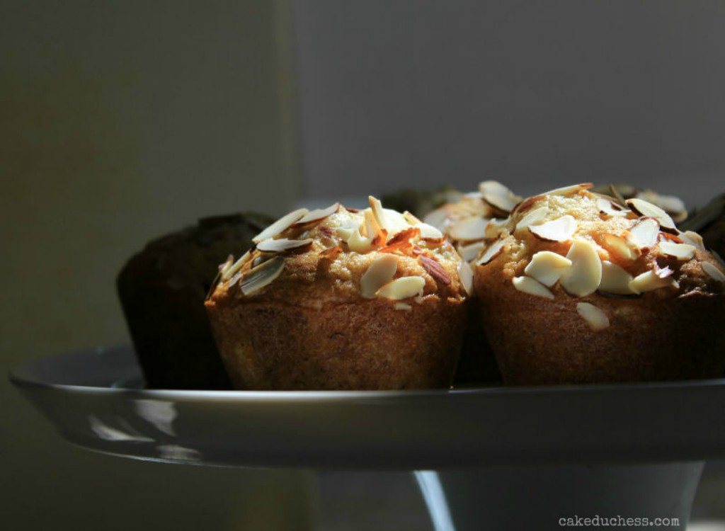 overhead image of muffins on a white dish