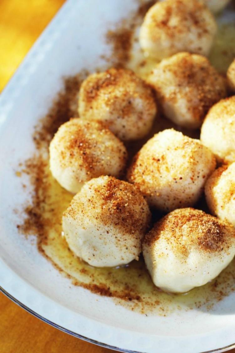 overhead image of dumplings on white plate