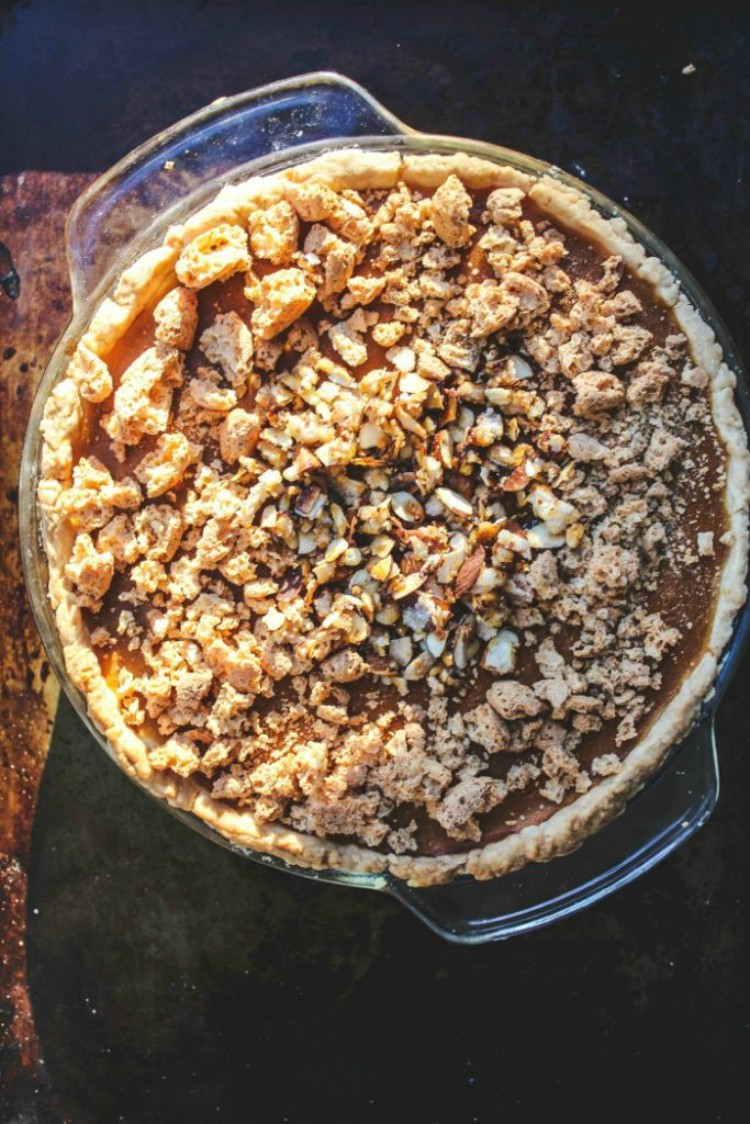 overhead shot of cookie topped pumpkie pie on a baking sheet
