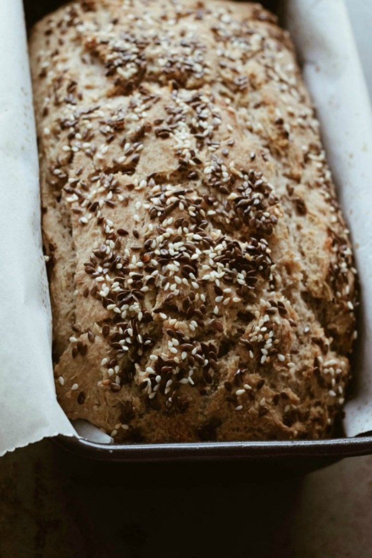 overhead image of loaf of bread with seeds on top