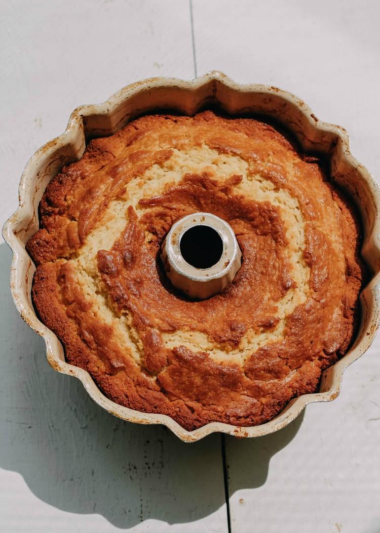 bundt cake with lemon curd filling in pan