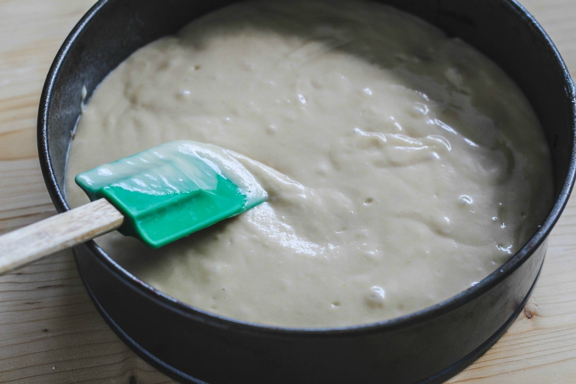 batter for an easy pineapple upside down cake in a deep dish cake pan