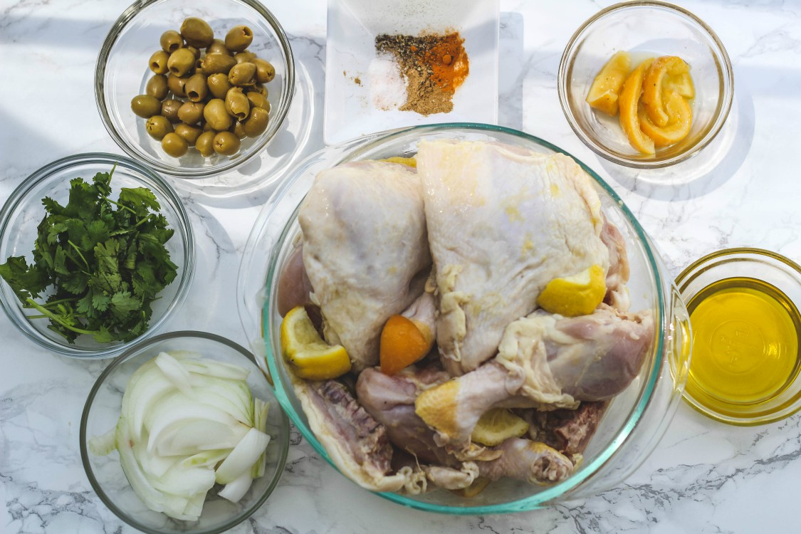 overhead image of making chicken with preserved meyer lemons and olives