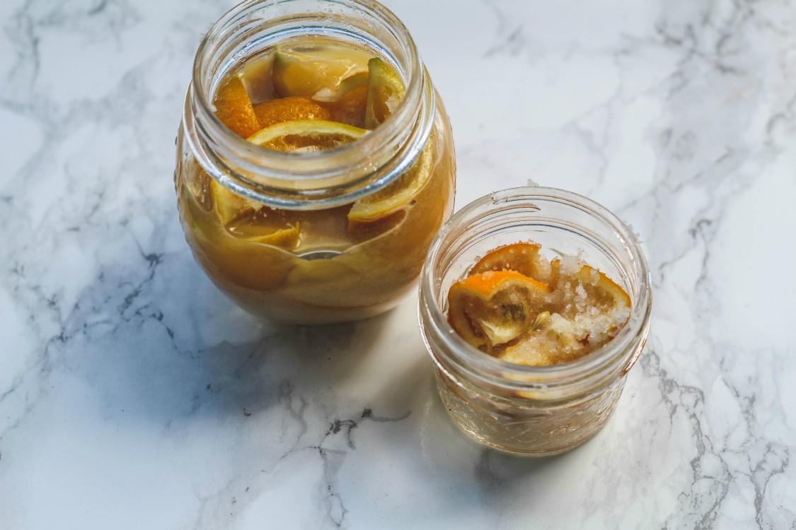 overhead image of making preserved lemons in jars