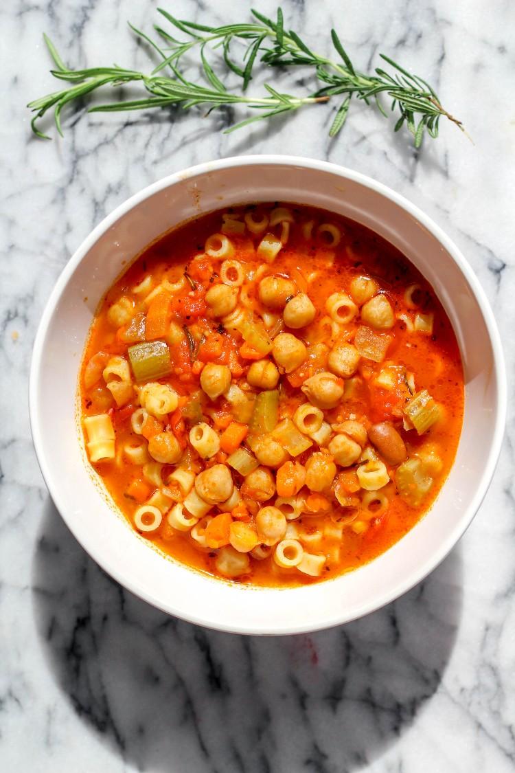overhead image of pasta e ceci on white bowl
