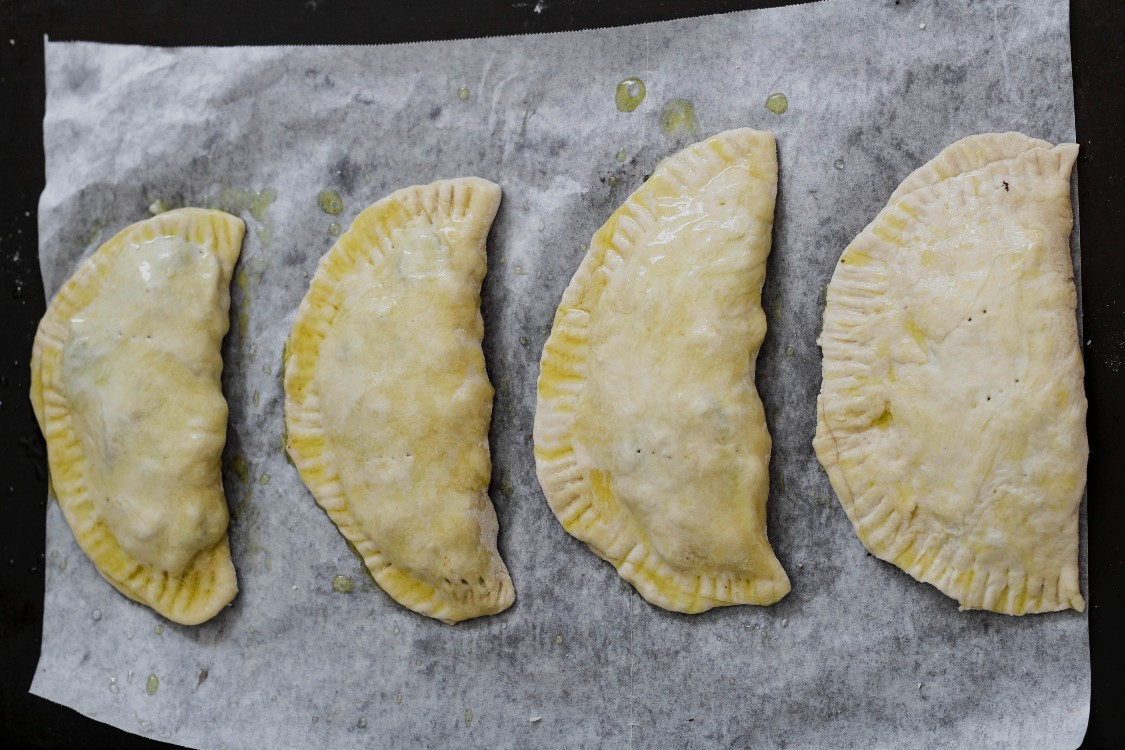 image of small scacciata's on baking sheet