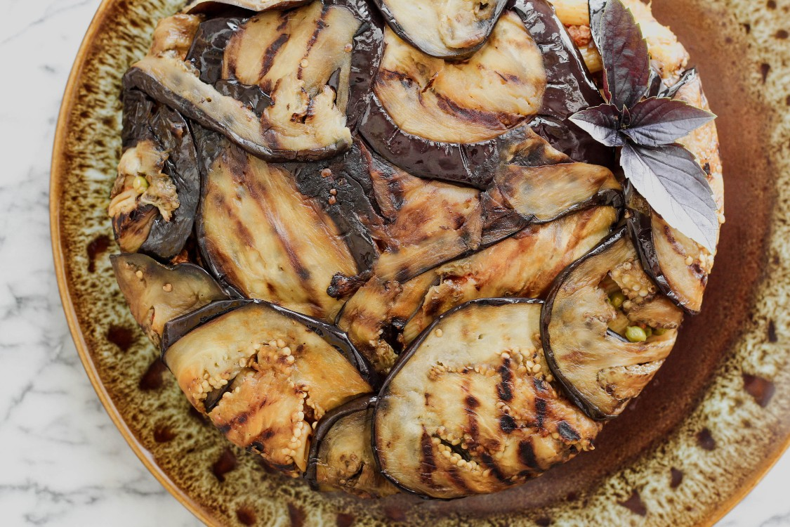 image of Eggplant Timbale-Timballo di Melanzane on a brown plate