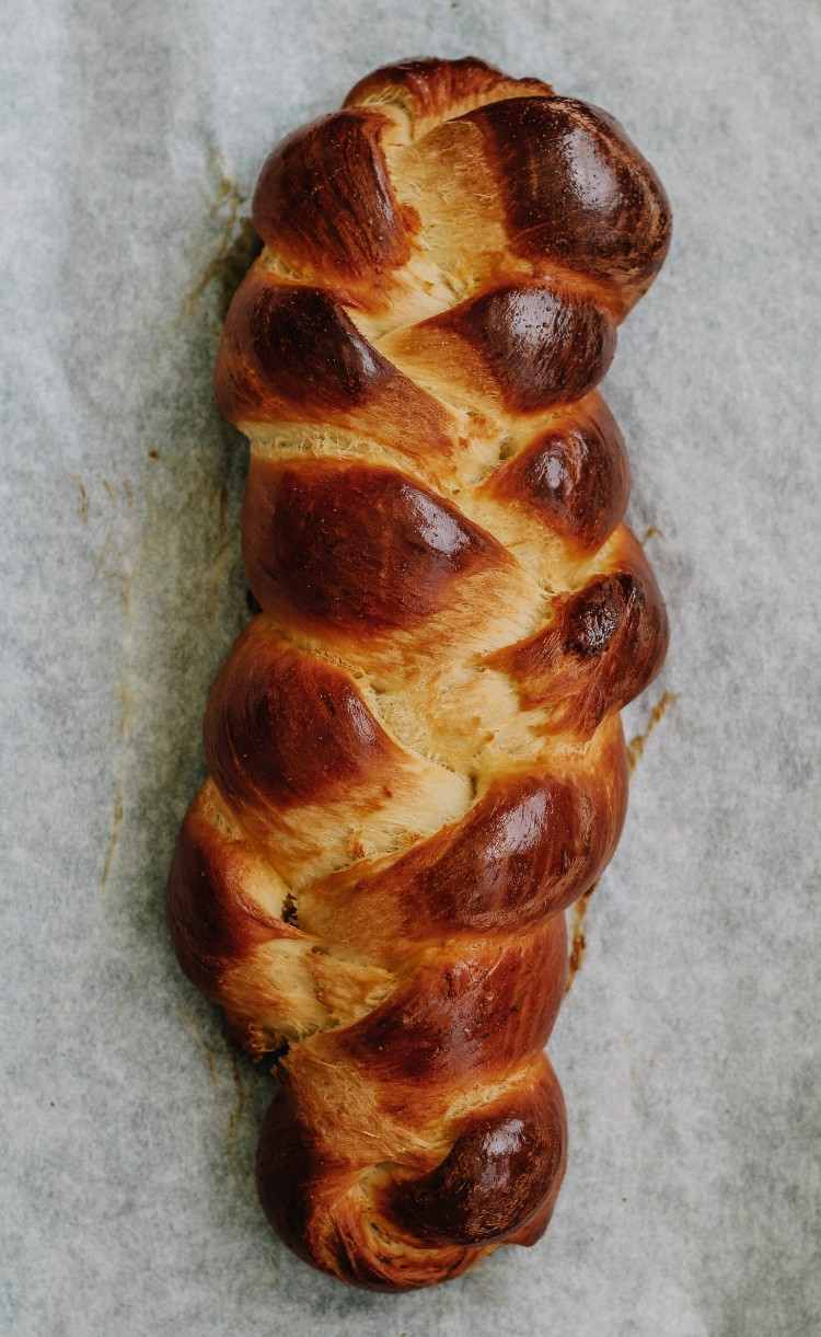 overhead image of challah on parchment paper