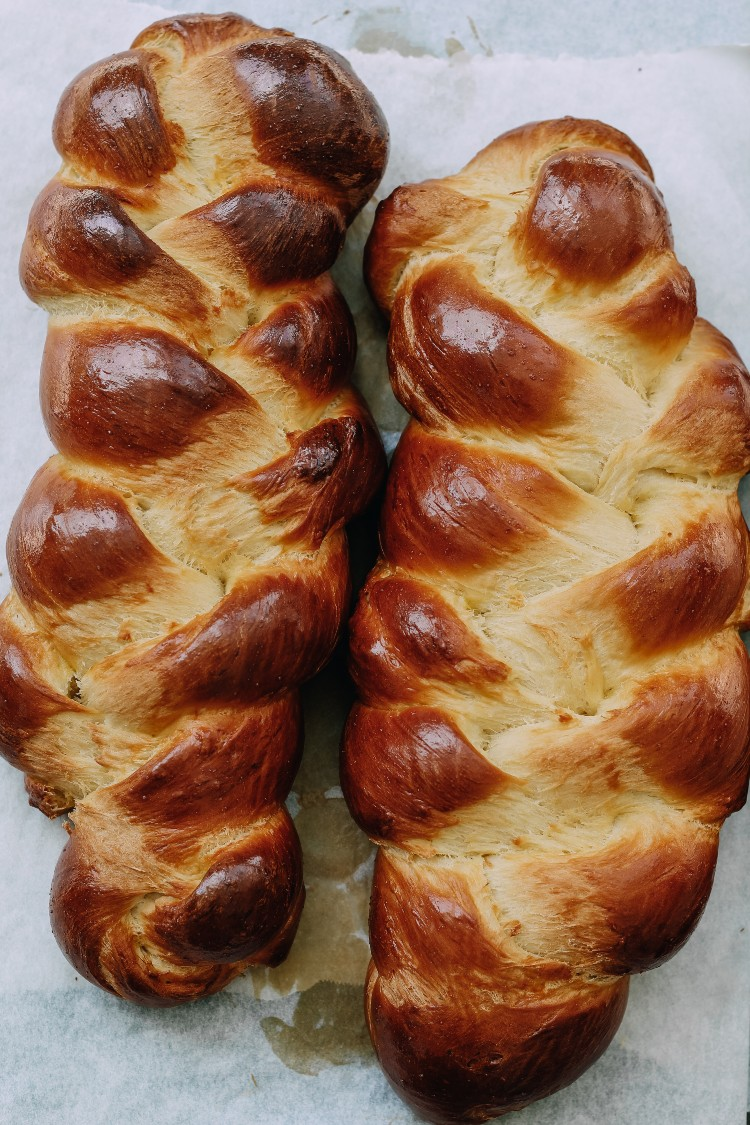 overhead image of braided loaves on baking sheet