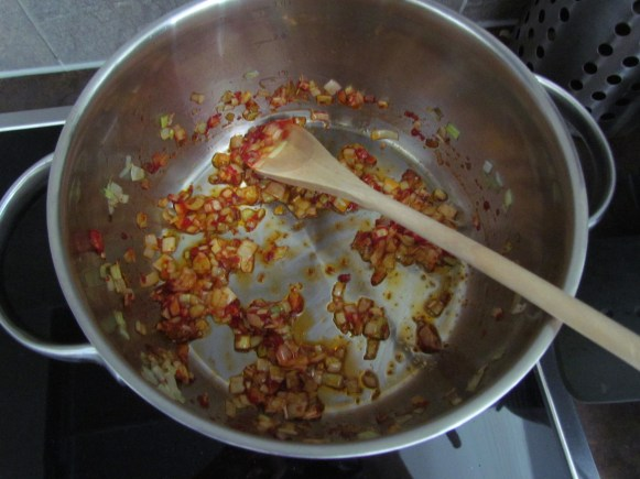 frying leek in tomato paste | www.savormania.com