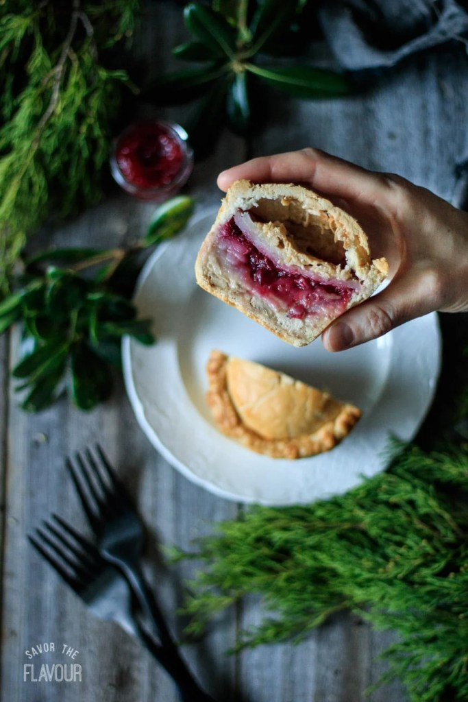 Leftover Turkey and Cranberry Mini Pies: an easy comfort food dinner recipe packed with dark meat turkey, cranberry sauce, potatoes, onion, and creamy gravy. Your family will love having these mini meat pies for dinner tonight!   www.savortheflavour.com #thanksgivingleftovers #turkey #cranberry #meatpie #pastry