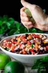 person squeezing lime juice onto cowboy caviar
