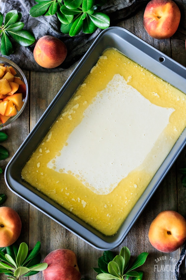 peach cobbler batter in pan