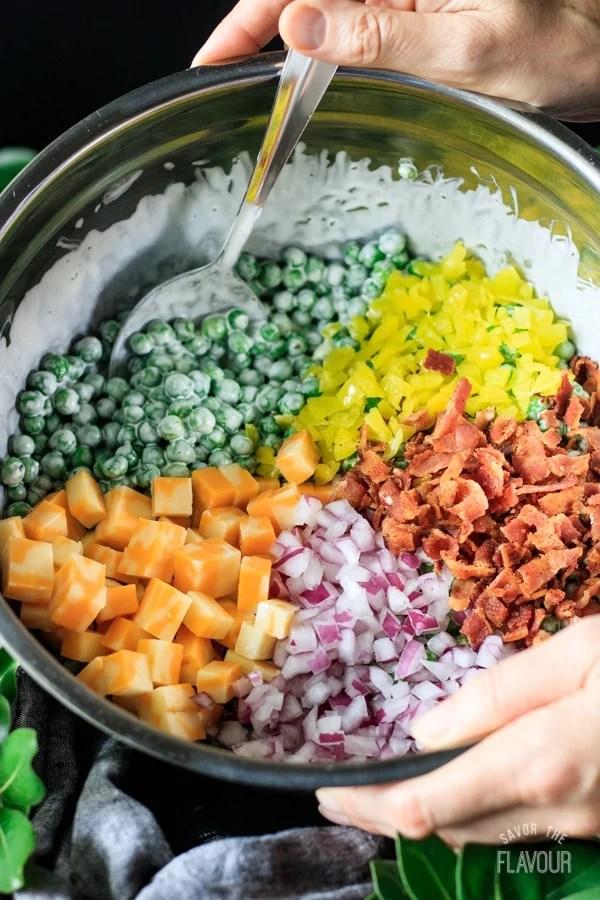 pea salad ingredients in a large bowl