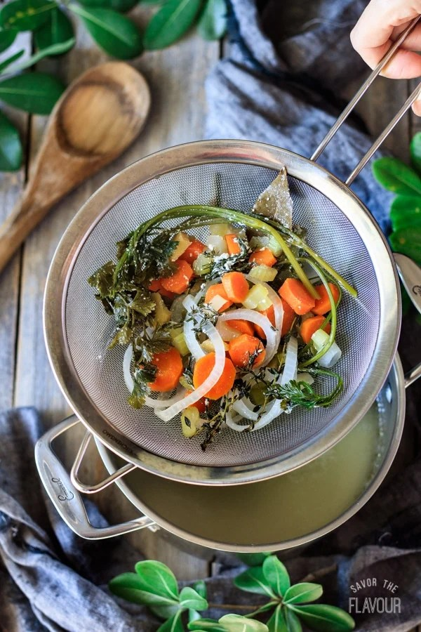 strained veggies from poached chicken