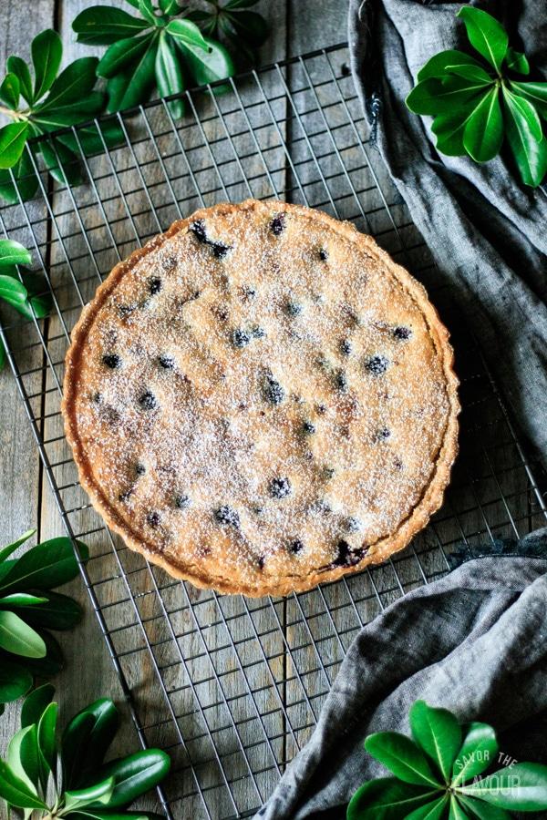 baked and decorated blueberry frangipane tart