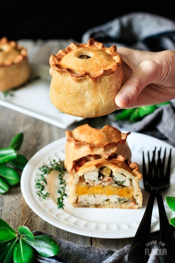 holding a chicken, bacon, and apricot pie