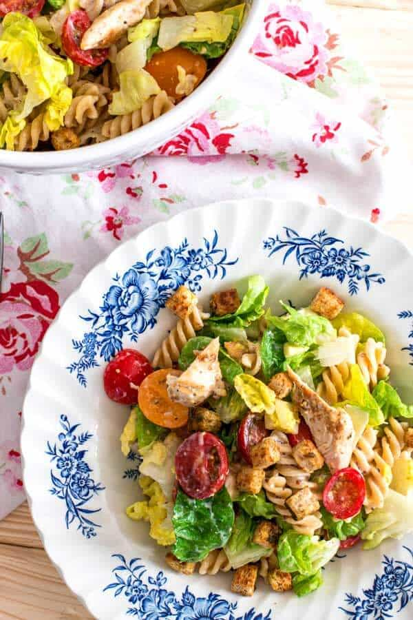 Are you looking for a healthy pasta salad for your next summer BBQ or potluck? This chicken caesar salad is just perfect!