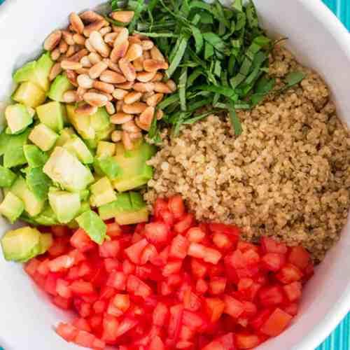 close up view of unmixed quinoa salad in a bowl