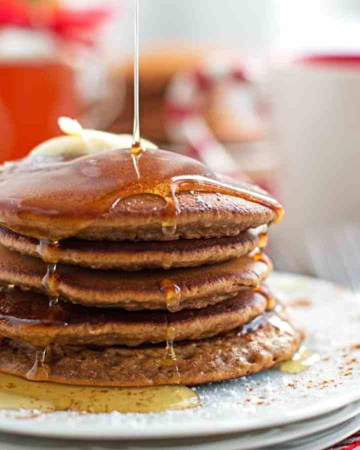 The best soft and fluffy Gingerbread Pancake recipe! This is perfect for breakfast on Christmas Morning because they are super quick and easy to make! Pancakes that taste like gingerbread cookies!