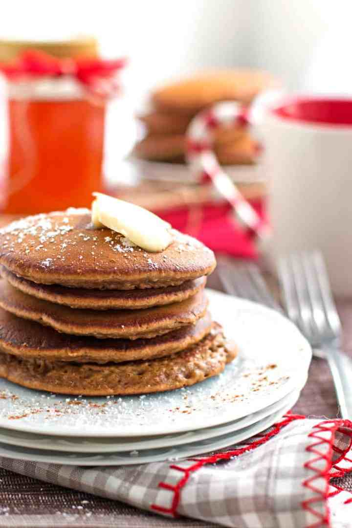 view of festive table with two plates with stacks of gingerbread pancakes