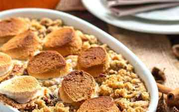 sweet potato casserole in a white baking dish on a set holiday table
