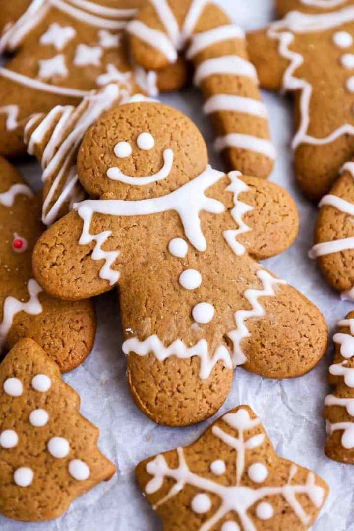 a gingerbread man lying on top of other gingerbread cookie shapes