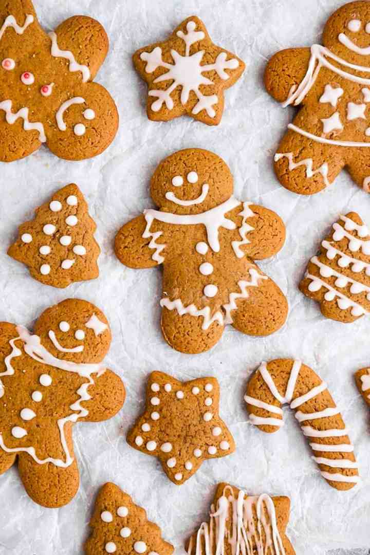 gingerbread cookies on a sheet of baking parchment