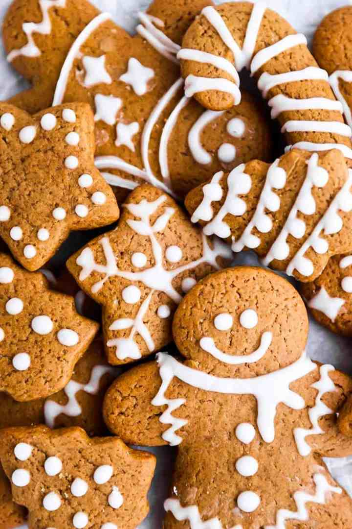 pile of cut out gingerbread cookies with icing