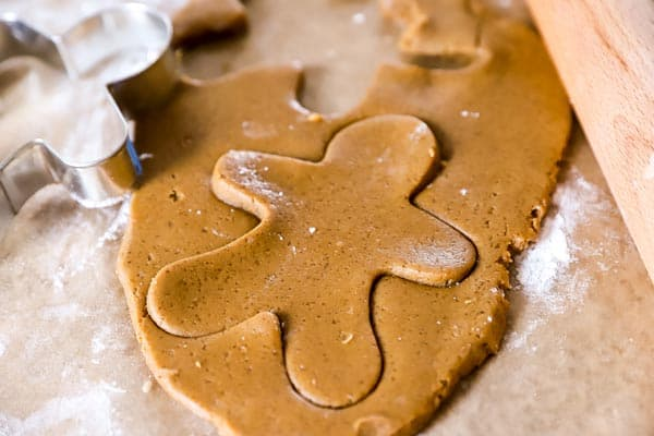 gingerbread dough with a gingerbread man cut out