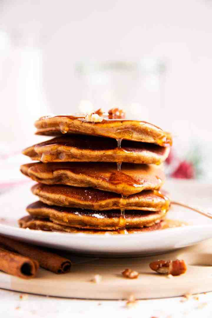 stack of gingerbread pancakes on a white plate