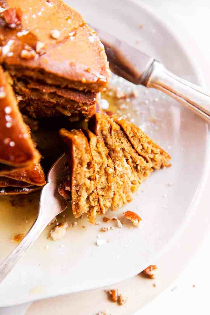 close up of cut up gingerbread pancakes on a white plate